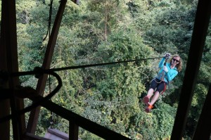 Alison ziplining into our treehouse, which is the only way to access it.