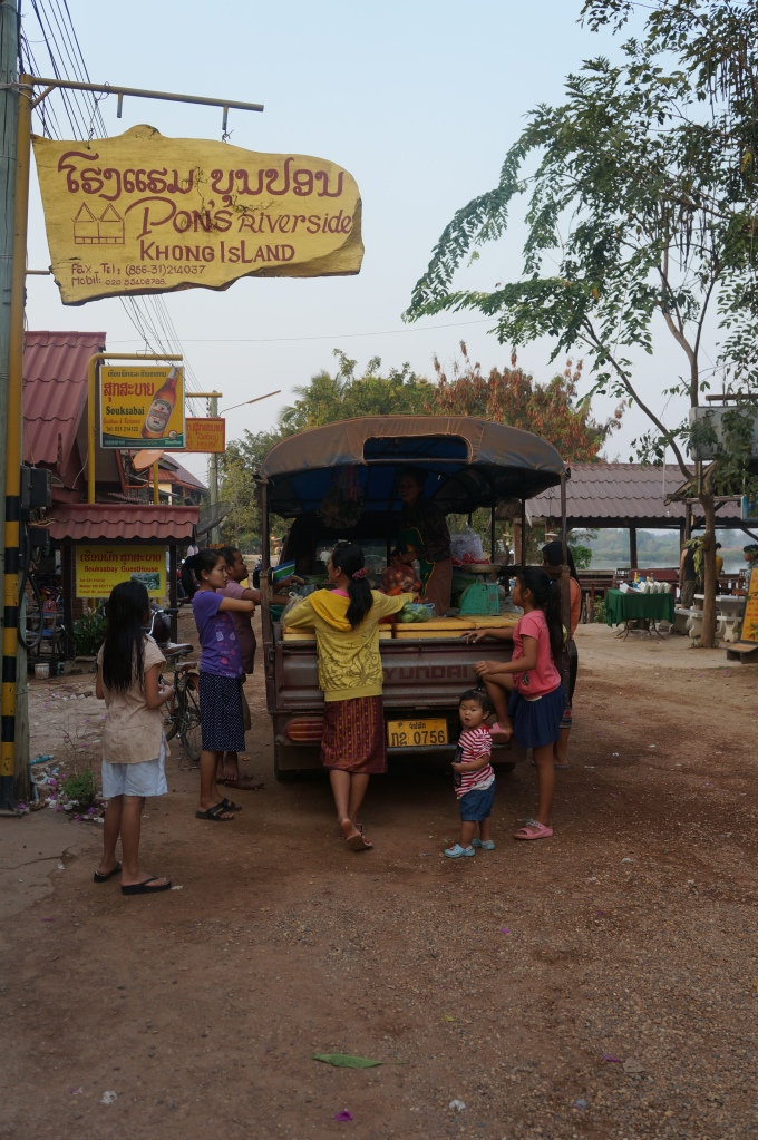 Locals buying produce for their restaurants from a grocery store on wheels! Yes, that is a songthaew.