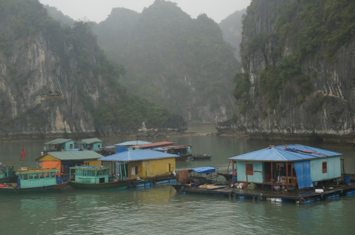 Floating village surrounded by karst formations