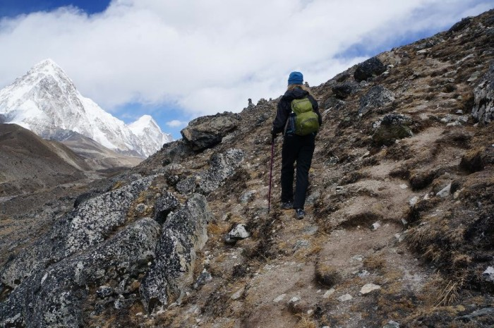 Hiking up a hill near Lobuche