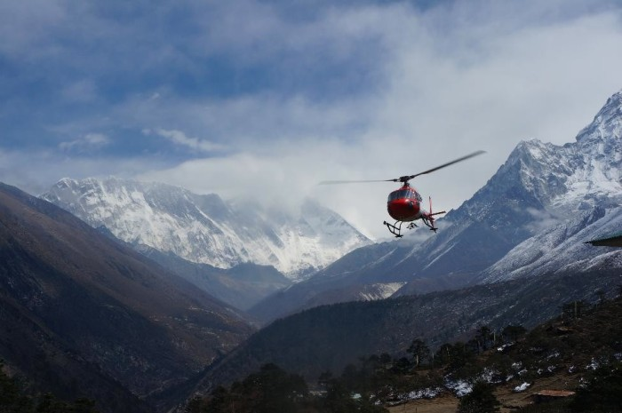 Chopper in Tengboche evacuating a fellow trekker from Richmond.