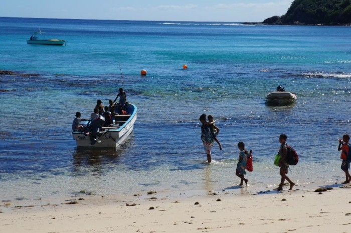 "The local children getting on their ""bus"" to head to another island for school."
