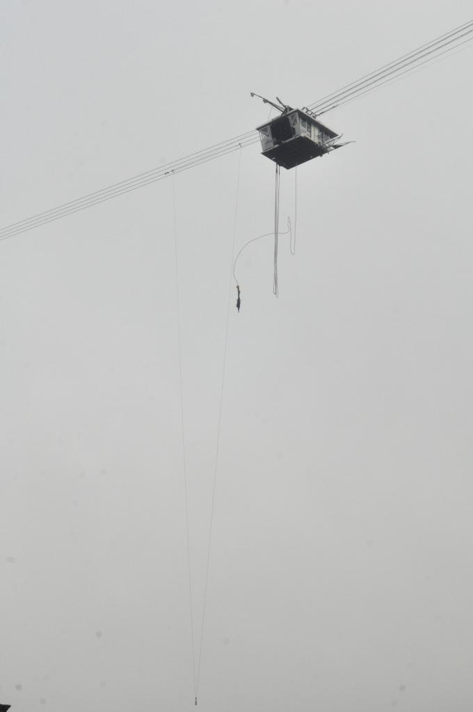 That's Alison jumping off that suspended cable car