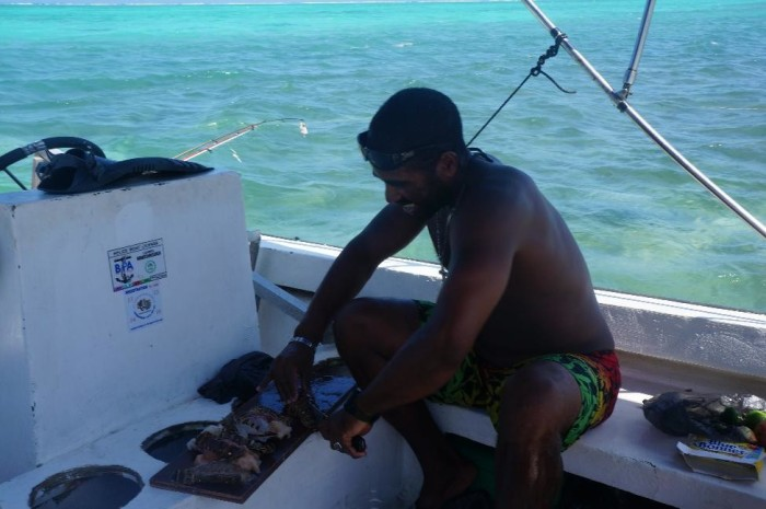 Scuba Steve preparing a freshly caught lobster lunch during our full day of snorkeling and boating
