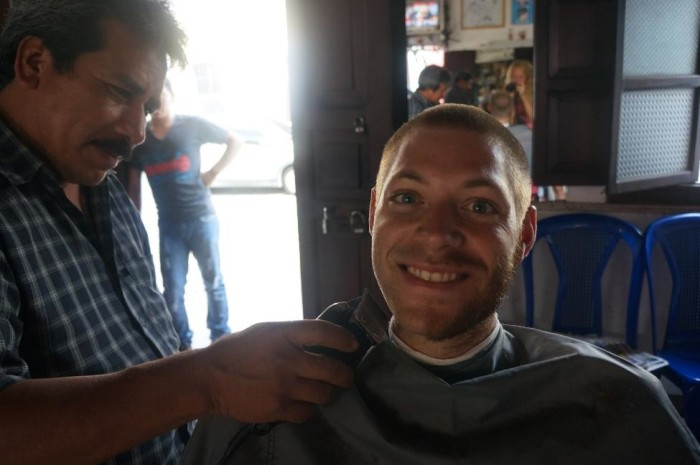 Brian enjoying his first barber cut shave!